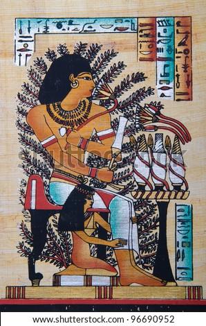 Fragment of egyptian papyrus - stock photo