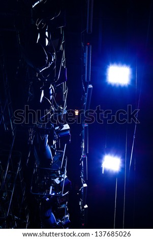 Fragment of equipment for stage lighting in blue light - stock photo