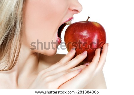 Fragment of female face with red apple, isolated on a white background