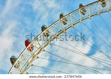 Fragment of ferris wheel against a blue sky - stock photo