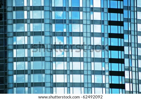Fragment of glass facade office modern building - stock photo