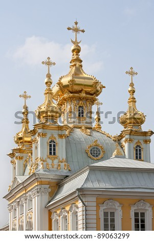 Fragment of  golden domes and church building in Peterhof, Russia.
