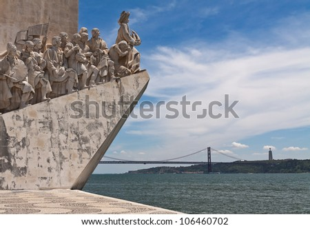 Fragment of Monument to Discoveries (Padrao dos Descobrimentos) with 25th of April bridge on background, Lisbon, Portugal - stock photo
