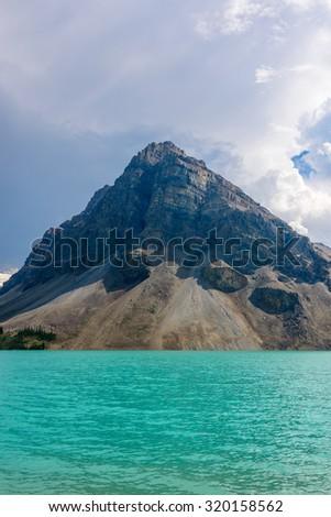 Fragment of mountain lake trail in Alberta, Canada, Rocky Mountains. Bow Lake. - stock photo