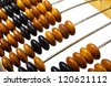 Fragment of old abacus on white background - stock photo