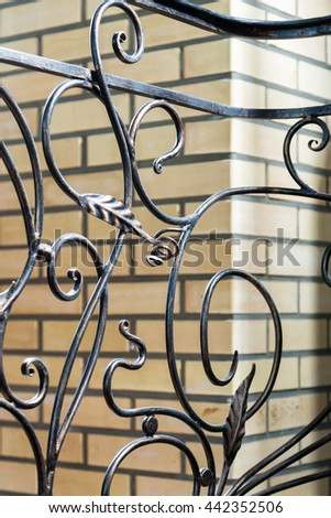 fragment of ornate fencing forged metal products - stock photo