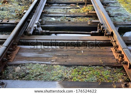 Fragment of Railway track with switch - stock photo