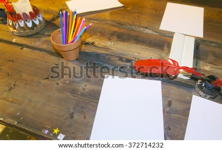 Fragment of room with pencils and paper on the table at Santa Claus Park in Rovaniemi that is in Lapland in Finland on the Arctic pole circle - stock photo