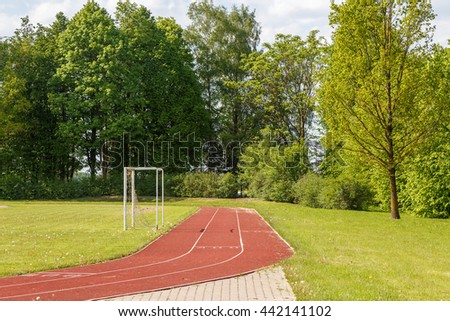 fragment of  running track in the village,Code,Latvia - stock photo