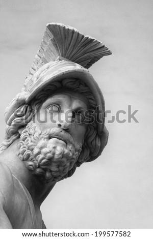 "Fragment of sculpture ""Menelaus supporting the body of Patroclus"". The ancient Roman sculpture. Loggia dei Lanzi, Piazza della Signoria. Florence, Italy - stock photo"