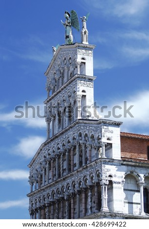 Fragment of the Church of San Michele, Roman Catholic basilica church in Lucca, Italy  - stock photo