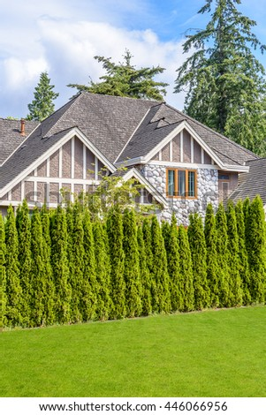 Fragment of the house with nice window and green fence. - stock photo