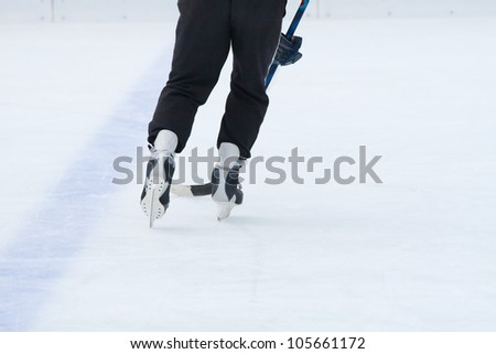 Fragment of the ice hockey game - stock photo