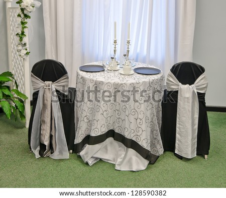 Fragment of the Interior of a wedding banquet in restaurant, reception venue   tables.