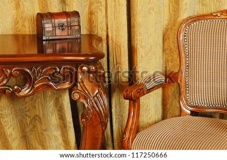 Fragment Of The Interior With Antique Furniture And Coffret On The Table - stock photo