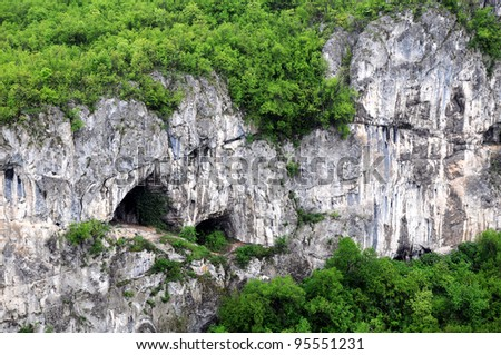 Fragment of the limestone rock in Balkan mountains near the cities of Dryanovo and Veliko Tarnovo in Bulgaria - stock photo
