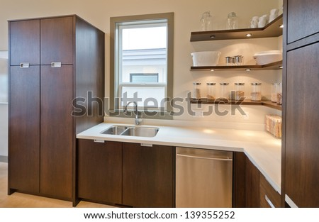 Fragment of the luxury modern kitchen with some shelves. Interior design. - stock photo