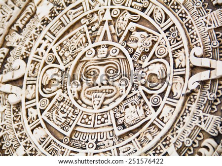 Fragment of the Mayan symbolic sun carved on the stone - stock photo