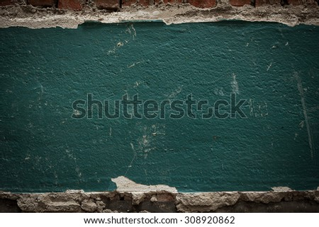 fragment of the old wall of green color - stock photo