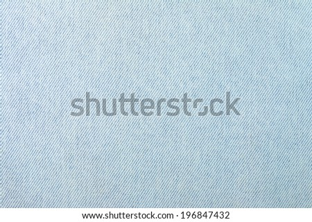 Fragment of the old worn blue denim. - stock photo