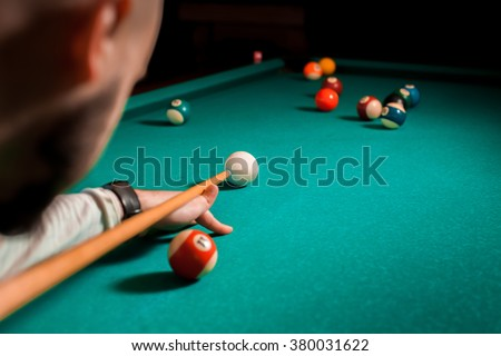 Fragment of the pool billiard game in process. American pool billiard. Pool billiard game. Billiard sport concept. - stock photo