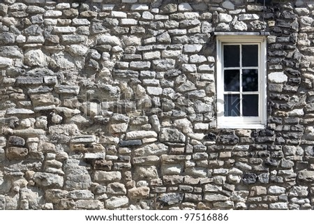 Fragment of the Tower castle at London with window - stock photo
