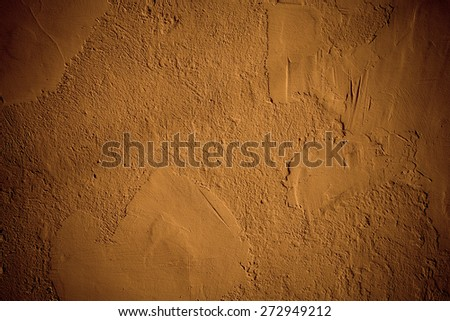 fragment of the wall with decorative plaster brown - stock photo