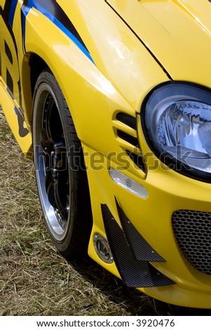 Fragment of the yellow sports machine - stock photo