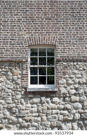 Fragment of Tower castle at London with window - stock photo