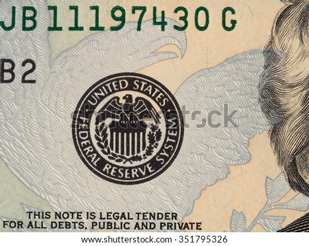 Fragment of us 20 dollar bill with Seal of the Federal Reserve System macro, united states money closeup - stock photo