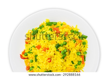 Fragment of white dish with boiled rice, cooked with turmeric, with boiled vegetables - carrots, bell peppers, green peas, green beans closeup. Isolation on a light background. - stock photo