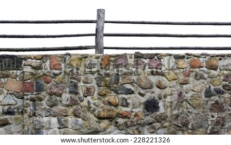 Fragment old granite wall of a medieval castle isolated