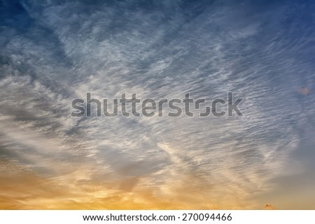 Fragment sky with clouds at sunrise - stock photo
