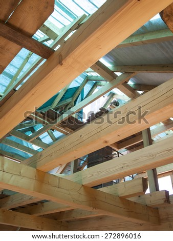 fragment structure wooden log home under construction - stock photo