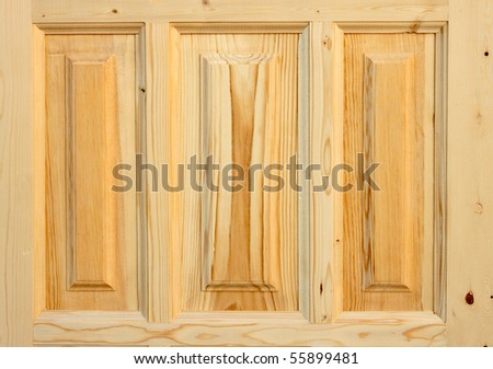 Fragment wooden door made of coniferous tree on white background