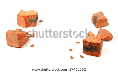 Fragments of shattered brick isolated over white - stock photo