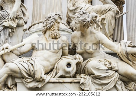 Fragments of the Pallas Athena fountain, in front of the Austrian Parliament Building. The figures symbolize the rivers Danube, Inn, Elbe and Moldau. Vienna, Austria, Europe. - stock photo