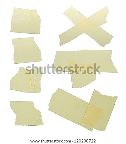 Fragments of torn yellow scotch on white background - stock photo