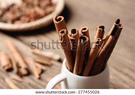 fragrant cinnamon sticks in white cup - stock photo