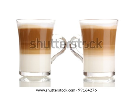 Fragrant coffee latte in glass cups isolated on white - stock photo