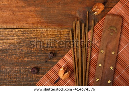 fragrant incense on a brown wooden background - stock photo