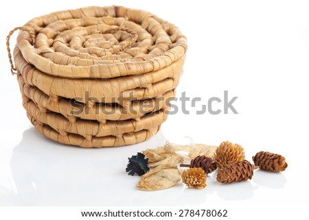 Fragrant natural potpourri with dried flowers, leaves and spices with a basket background on white   - stock photo
