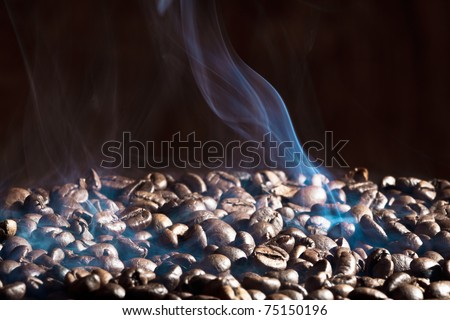 Fragrant roasted coffee beans on black background - stock photo