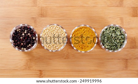 Fragrant spices. Isolated on wooden background - stock photo