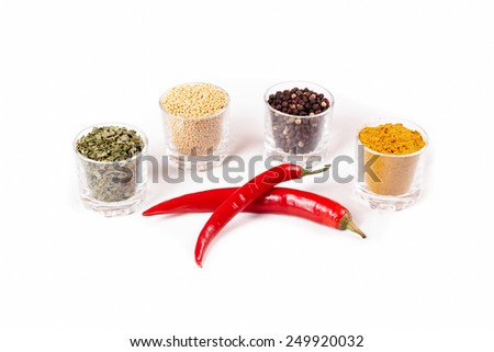 Fragrant spices with red pepper. Isolated on white - stock photo