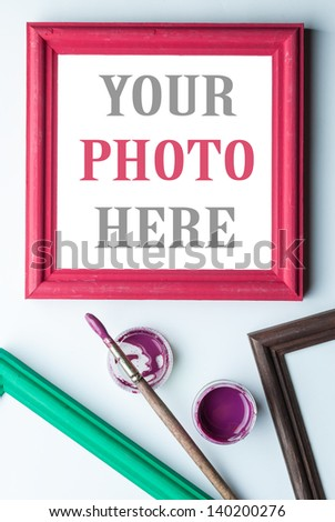 Frame, acrylic paint and pain brush. Places for your photo or text. - stock photo