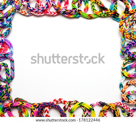 Frame border made out of loom bracelets on a white background - stock photo