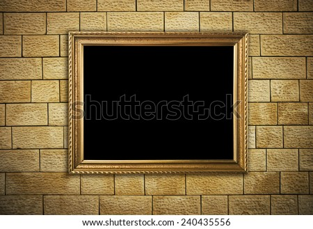 frame hanging on brick wall - stock photo