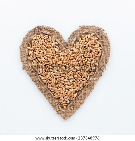Frame in the shape of heart with wheat, on a white background