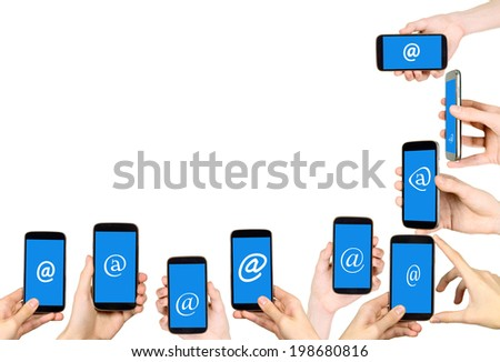Frame made from hands which are holding mobile phones - stock photo